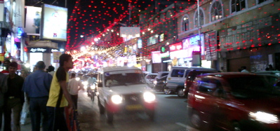Brigade Road by night.  Go shopping.