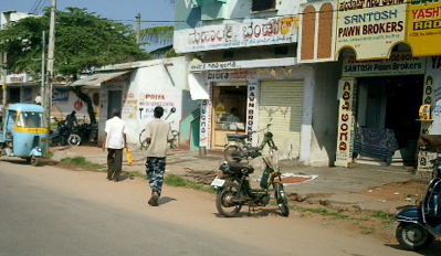 Mysore, notice the Kannada script on the shops