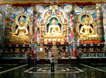 Big golden statues inside the Tibetan temples