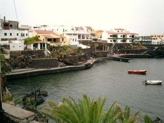 The port of Tamaduste with people bathing on the far side